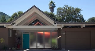 Two Marin County installations by Northgate Garage Doors illustrate how traditional roll-up garage doors can dovetail well with the Eichler aesthetic when they are re-faced with Eichler siding. Note the visible horizontal lines on each example, a minor drawback.