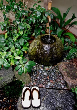 The Briscos' calm Asian-style atrium garden.