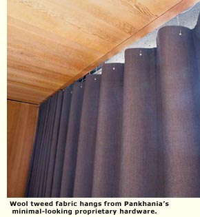 Wool tweed fabric hangs from Pankhania's minimal-looking proprietary hardware.