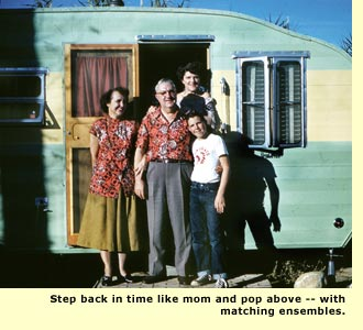 family in front of trailer