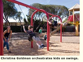 residents on swings in park