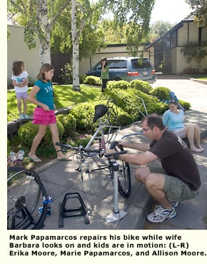 primewood dad fixing bike with kids and wife